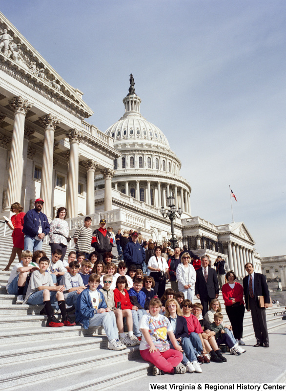 Photograph of Congressman Nick J. Rahall with an unidentified school group outside of the Capitol Building