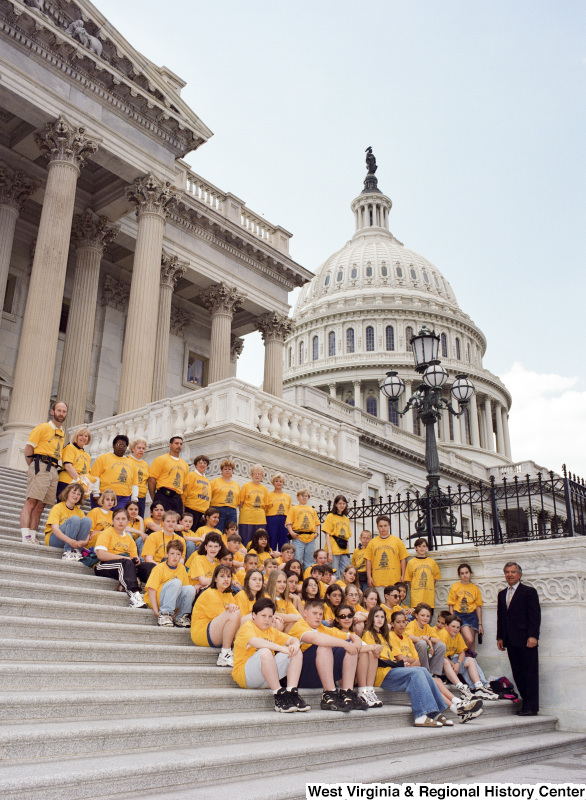 Photograph of Congressman Nick Rahall with a group of students from Bradley Elementary School at the Capitol