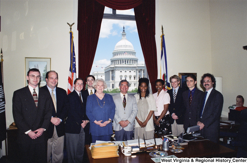 Photograph of Congressman Nick J. Rahall in his office with a group of unidentified people