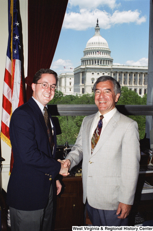 Photograph of Congressman Nick J. Rahall posing with an unidentified man in his office