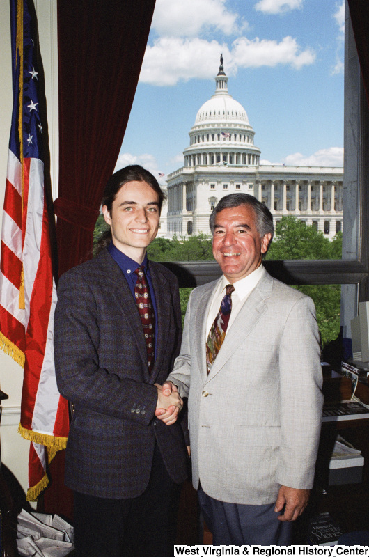 Photograph of Congressman Nick J. Rahall in his office with an unidentified visitor