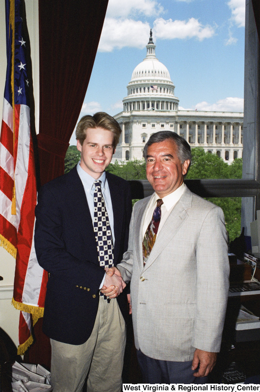 Photograph of Congressman Nick J. Rahall posing in his office with an unidentified visitor