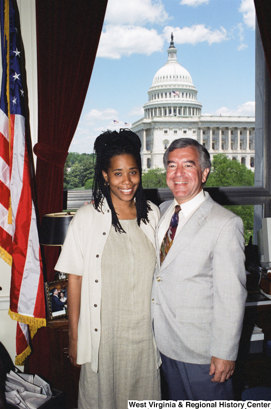 Photograph of Congressman Nick Joe Rahall posing in his office with an unidentified visitor