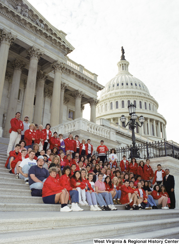 Photograph of Congressman Nick Joe Rahall with an unidentified school group posing on the steps of the Capitol