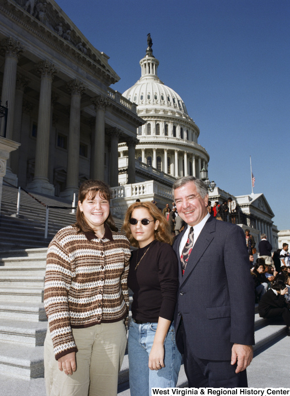 Photograph of Congressman Nick Rahall posing at the Capitol with two unidentified women