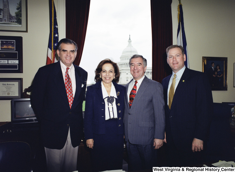 Photograph of Congressmen Nick Rahall and Ray LaHood with other unidentified people