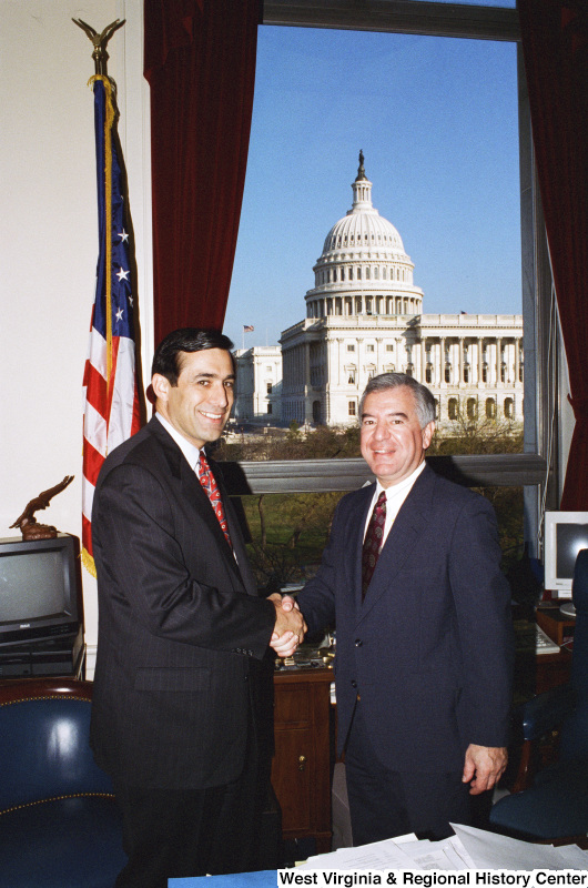 Photograph of an unidentified man and Congressman Nick Rahall shaking hands