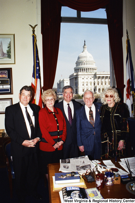 Photograph of Congressman Nick J. Rahall posing in his office with a group of unknown people