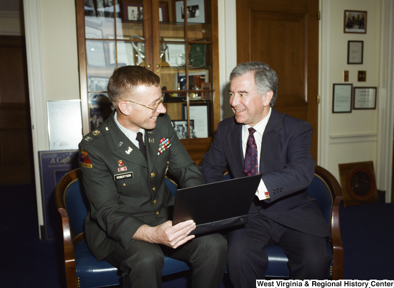 Photograph of Congressman Nick J. Rahall with a military officer named Robertson
