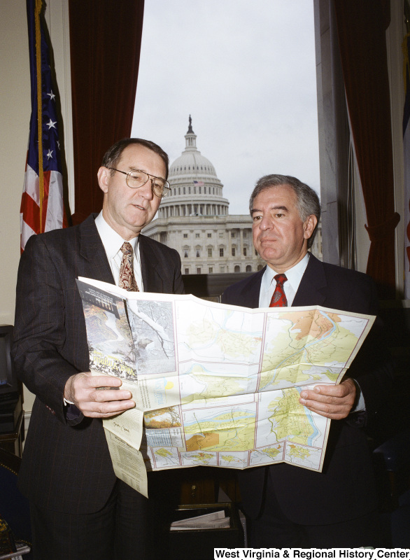 Photograph of Congressman Nick Rahall and an unidentified man looking at a map