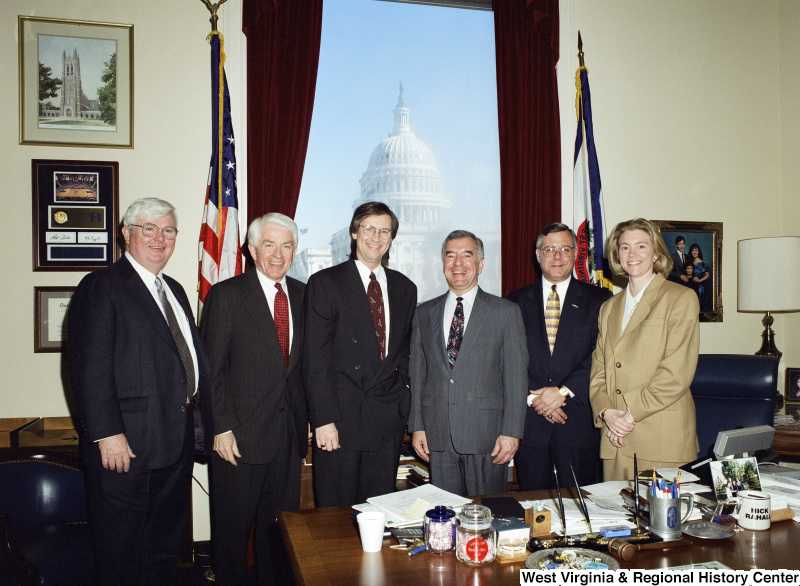 Photograph of Congressman Nick J. Rahall in his Washington office with five unidentified people