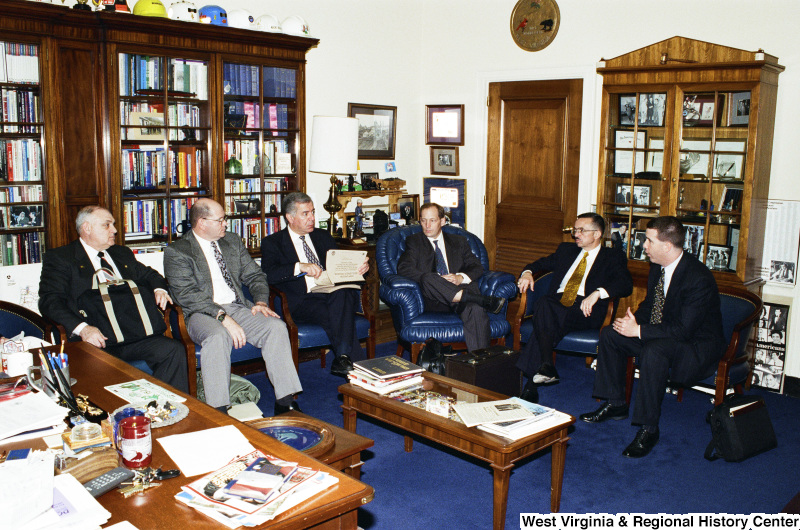 Photograph of Congressman Nick J. Rahall in an unidentified meeting with five other people