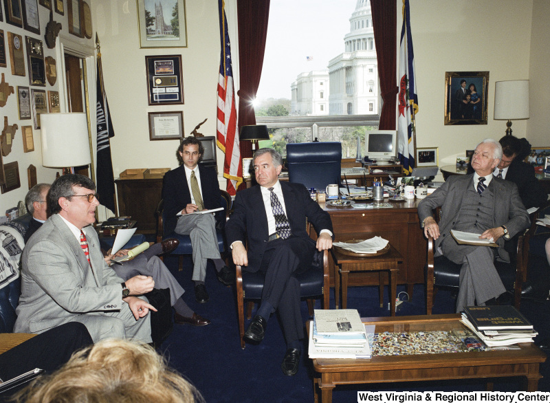 Photograph of Congressman Nick J. Rahall and Senator Robert C. Byrd in a meeting with others
