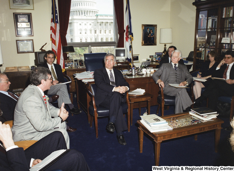 Photograph of Congressman Nick J. Rahall, Senator Robert C. Byrd, and others in a meeting