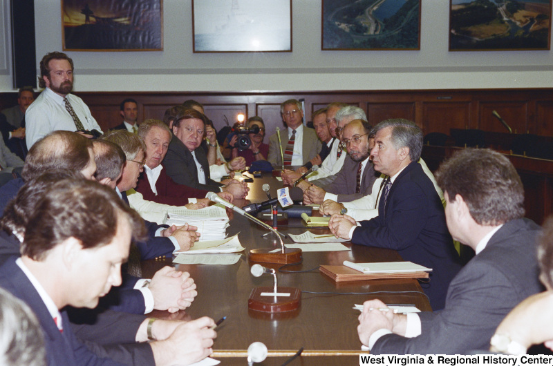 Photograph of Congressman Nick J. Rahall in a meeting with a group of unidentified people