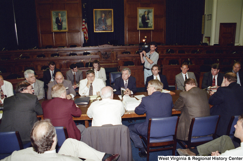 Photograph of unidentified people and Congressman Nick Rahall in a meeting