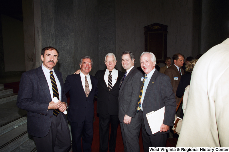 Photograph of Congressmen Nick J. Rahall, Alan Mollohan, and Senator Robert C. Byrd with others