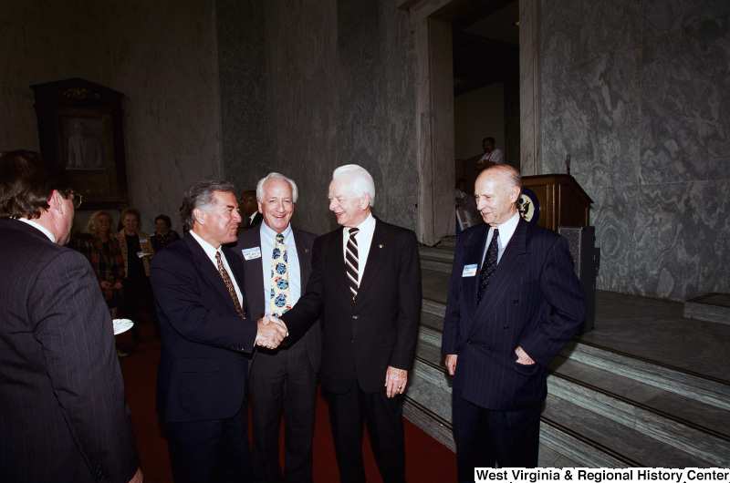 Photograph of Senator Robert C. Byrd, and Congressman Nick Rahall with Gary Croyton(?) and others