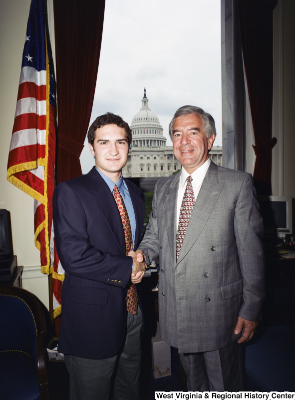 Photograph of Congressman Nick Rahall in his Washington office with an unidentified visitor