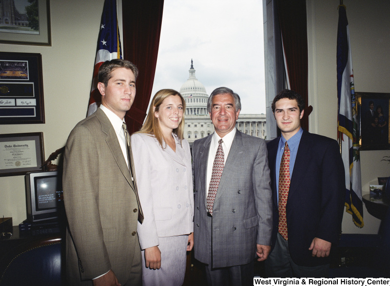 Photograph of three unidentified visitors to Congressman Nick J. Rahall's Washington office