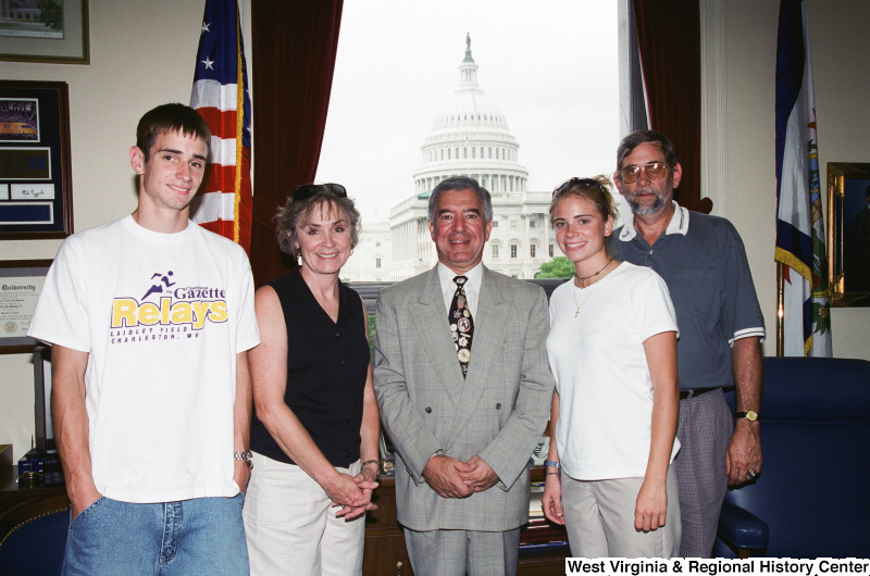 Photograph of an unidentified family visiting with Congressman Nick Rahall