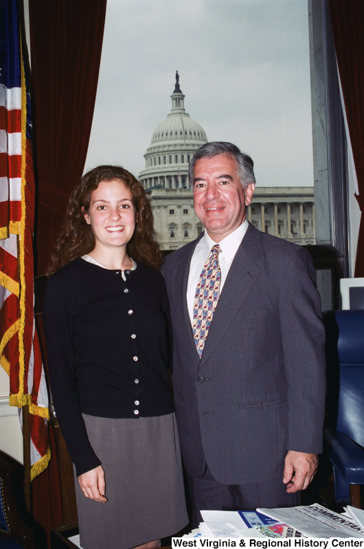 Photograph of Congressman Nick Rahall and an unidentified young lady in his Washington office