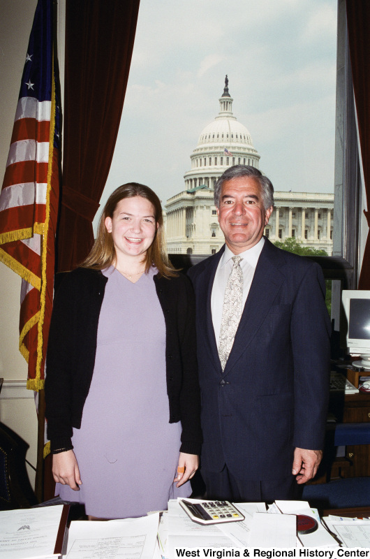 Photograph of Congressman Nick Rahall and an unidentified woman at his Washington office