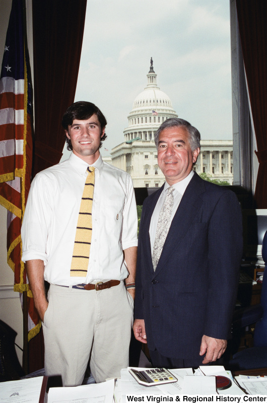 Photograph of Congressman Nick Rahall with an unknown young man in his Washington office