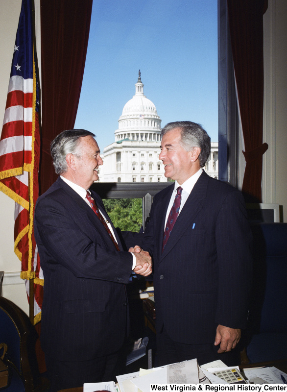 Photograph of Congressman Nick Rahall shaking hands with an unidentified man in his Washington, D.C. office