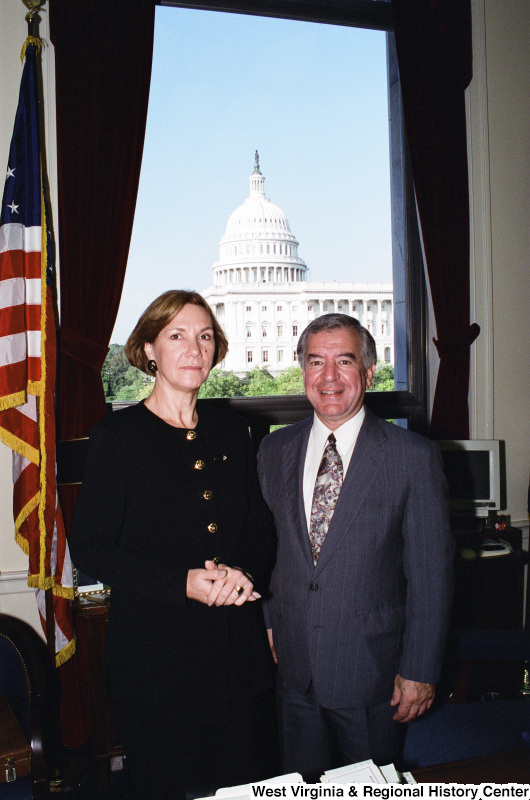 Photograph of an unidentified woman with Congressman Nick Rahall in his Washington office