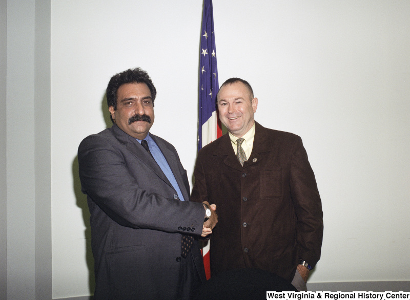 Photograph of Congressman Dana Rohrabacher (CA) with an unidentified man