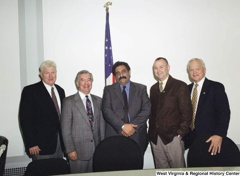 Photograph of Congressmen Nick Rahall, Dana Rohrabacher, and James Moran (VA) with others