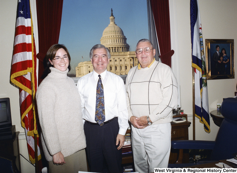 Photograph of Congressman Nick J. Rahall with two unidentified people visiting his Washington office