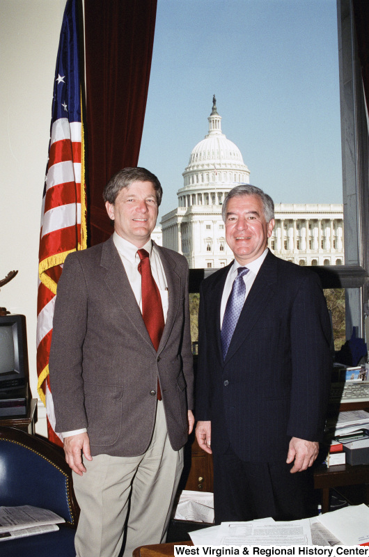 Photograph of Congressman Nick Rahall with an unknown visitor to his Washington office