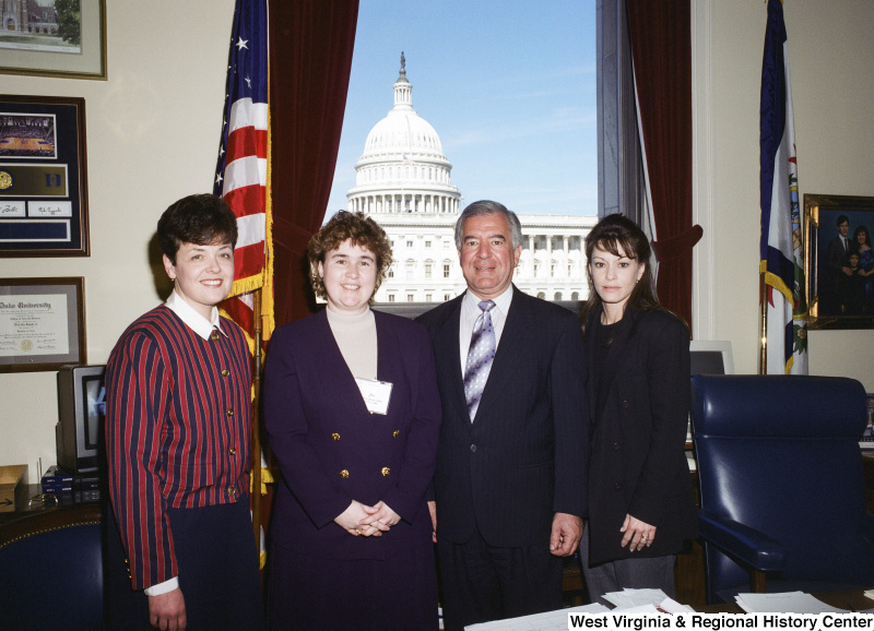 Photograph of Congressman Nick Rahall with three unidentified women