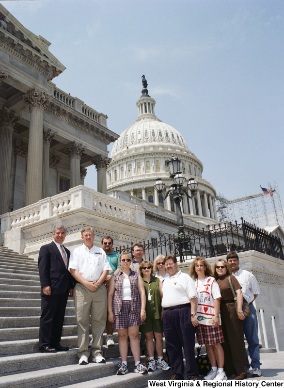 Photograph of a group of unidentified people visiting with Congressman Nick Rahall