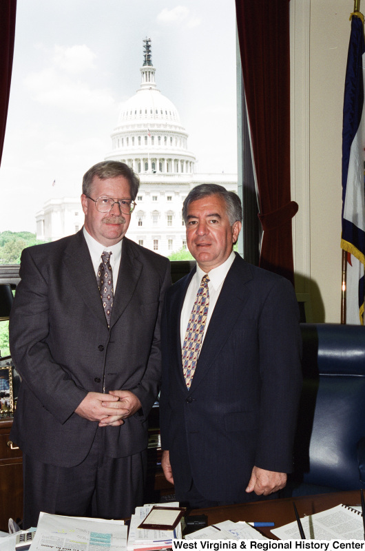 Photograph of an unidentified man visiting with Congressman Nick Rahall