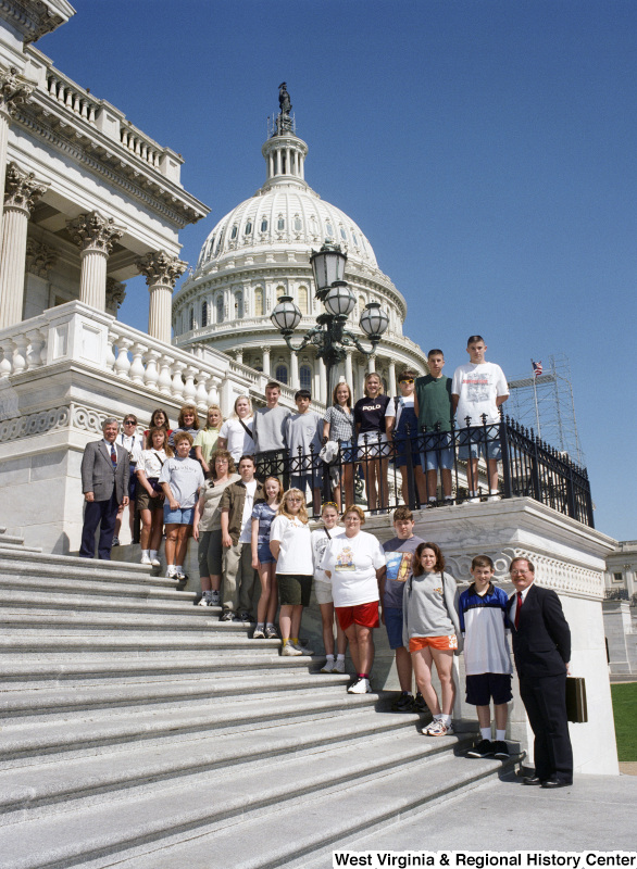 Photograph of Congressman Nick Rahall on the steps of the Capitol with a group of unidentified students