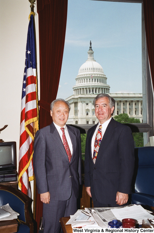 Photograph of Congressman Nick J. Rahall and an unidentified visitor in his Washington office