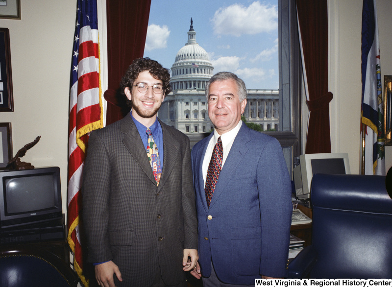 Photograph of an unidentified male visitor with Congressman Nick Rahall in his Washington office