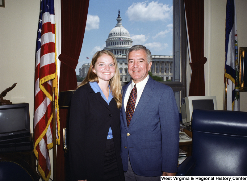 Photograph of an unidentified female visitor with Congressman Nick Rahall in his Washington office