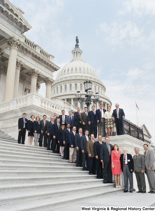 Photograph of Congressman Nick J. Rahall and a group of unidentified people posing on the steps of the Capitol Building