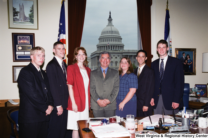Photograph of Congressman Nick Rahall in his Washington office with an unknown group of young professionals