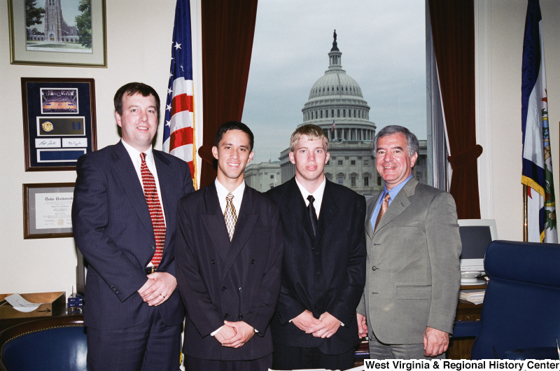 Photograph of Congressman Nick Rahall with a group of unidentified young professionals in his Washington office