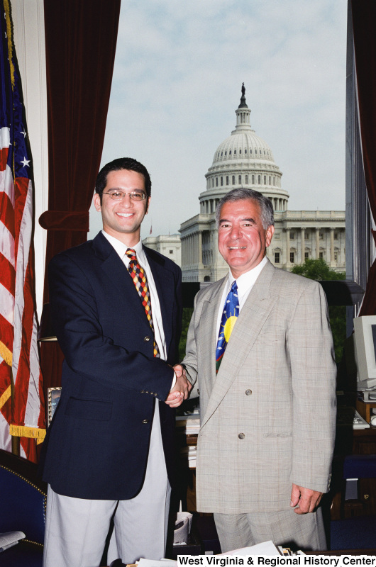 Photograph of Congressman Nick J. Rahall with an unidentified visitor to his Washington office
