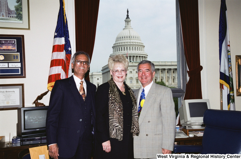 Photograph of Congressman Nick J. Rahall with two unidentified people in his Washington, D.C. office