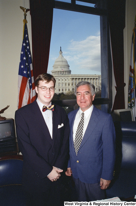 Photograph of an unidentified visitor and Congressman Nick J. Rahall in his Washington office