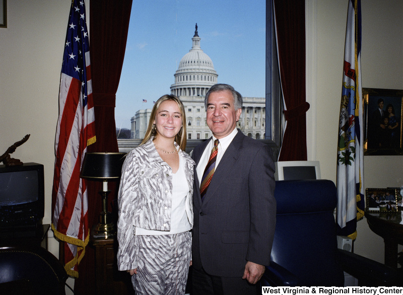 Photograph of an unidentified female visitor and Congressman Nick J. Rahall in his Washington office