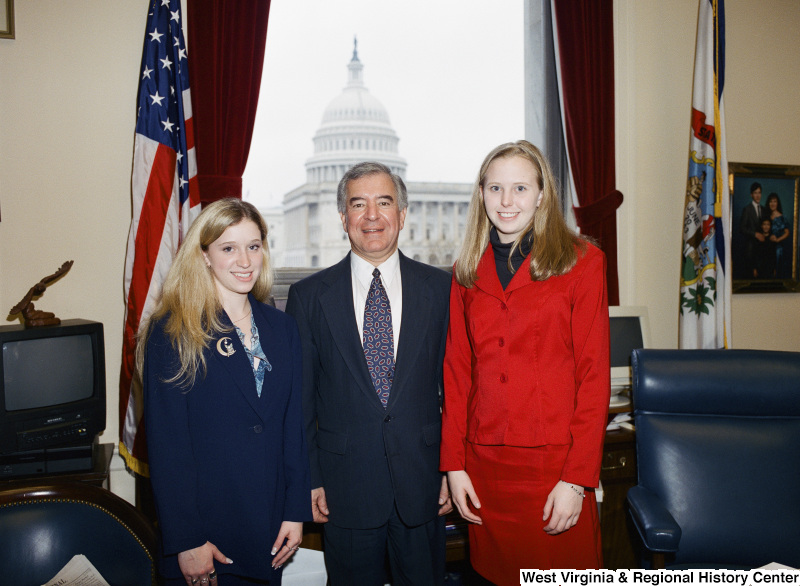 Photograph of Congressman Nick J. Rahall with two unidentified visitors to his Washington office