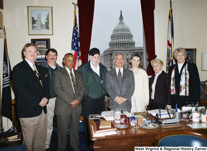 Photograph of Congressman Nick J. Rahall in his Washington office with seven unidentified visitors